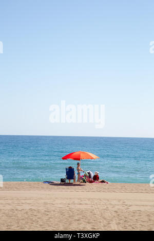A family day out on Benalmadena beach, Costa del Sol, Spain - Stock Image