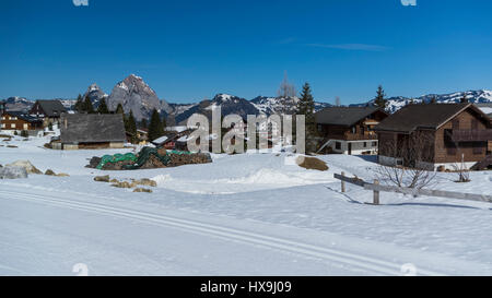 Stoos, Canton of Schwyz, Switzerland, a village and winter sports area in the Swiss Alps in winter. - Stock Image