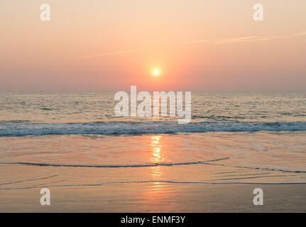 A beach at sunset - Stock Image
