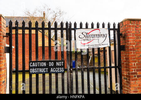 Funny amusing signs together, slimming world caution do not obstruct access sign funny together wonder which one - Stock Image