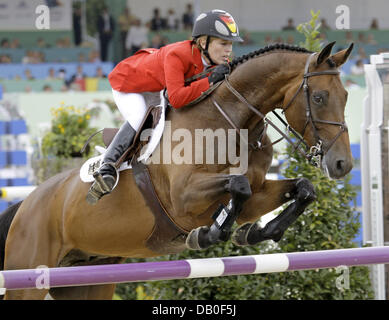 German Meredith Michaels-Beerbaum  and her horse Shutterfly  overcome an obstacle during the third qualification - Stock Image