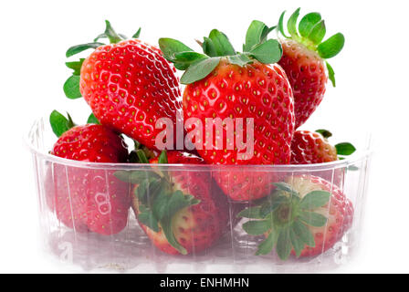 Strawberries in a plastic canister. - Stock Image