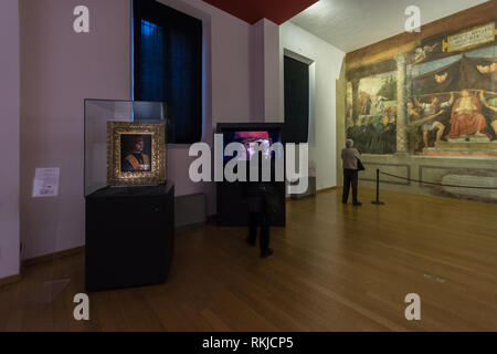One room of the Pinacoteca Ambrosiana art gallery in Milan; on the left, the ' Portrait of a Musician' painting by Leonardo da Vinci - Stock Image