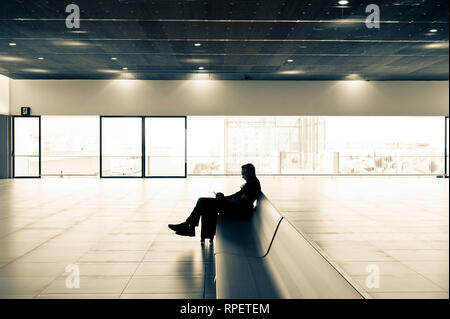 Traveller at airport waiting for flight. Corvera Airport, Murcia, Spain - Stock Image
