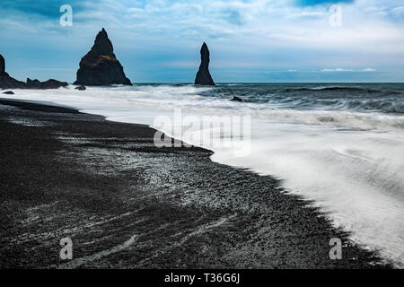 Reynisfjara is a world-famous black-sand beach found on the South Coast of Iceland, just beside the small fishing village of Vik. - Stock Image