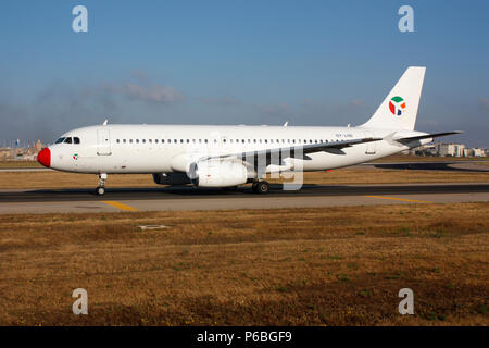 Danish Air Transport Airbus A320 passenger jet plane taxiing for departure from Malta. Civil aviation and air travel. - Stock Image