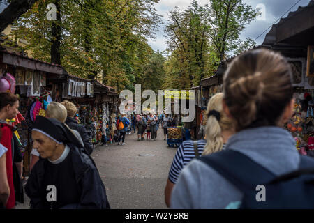 A bazaar in Saint Barbara Street where they sell souvenirs from the Black Madonna and Jasna Góra, Czestochowa, Poland 2018. - Stock Image