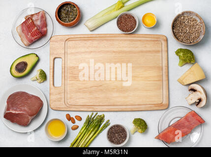Ingredients for ketogenic diet: meat, bacon, fish, broccoli, asparagus, avocado, mushrooms, cheese, sunflower seeds, - Stock Image
