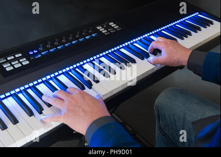 ENSCHEDE, THE NETHERLANDS - MARCH 29, 2018: A man is playing a keyboard - Stock Image