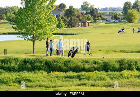Two queue up at the tee at a recreational golf course in Lakewood, Colorado - Stock Image