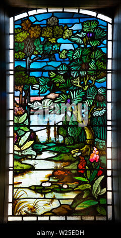 UK, Cumbria, Sedbergh, Marthwaite, St Gregory's church window, depicting natural riverside scene - Stock Image