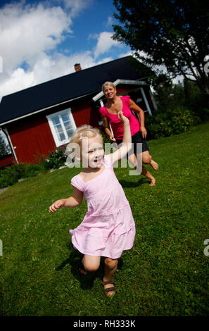 Mother playing with her daugther - Stock Image