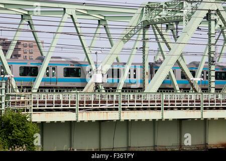 bridge blue and silver train commute travel Japan - Stock Image
