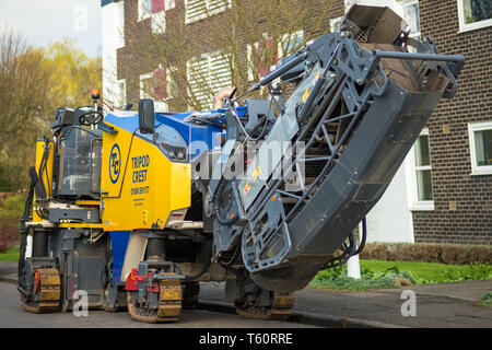 Asphalt Milling / cold planer machine used on Huntingdon Rd in Cambridge, UK. - Stock Image