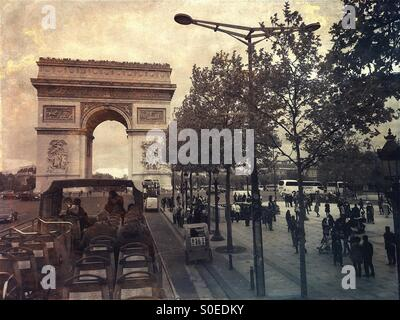 View of Arc de Triomphe from open air sightseeing bus on Avenue de la Grande Armée in centre of Place Charles - Stock Image