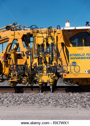Detail of tampers on Union Pacific HARSCO 6700SJ2 PD Production / Switch Tamper parked on siding in southwestern New Mexico, USA - Stock Image
