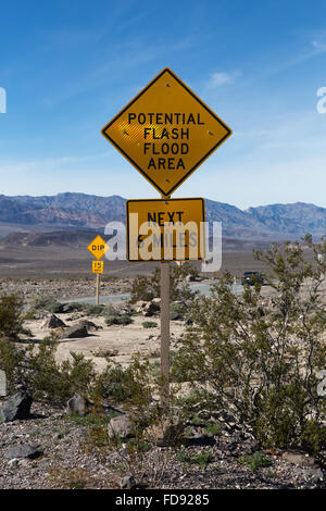Flash flood warning signs aon the roadside in Death Valley California warning visitors of potential flooding danger - Stock Image