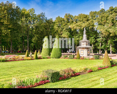 18 September 2018: St Petersburg, Russia - Peterhof Palace Gardens, with topiary and Wedding Cake Fountain. - Stock Image