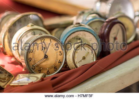 Vintage manual clocks exposed at a local street flee market - Stock Image