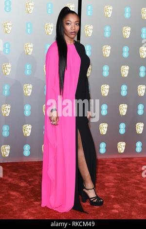 London, UK. 10th Feb, 2019. LONDON, UK. February 10, 2019: Naomie Akie arriving for the BAFTA Film Awards 2019 at the Royal Albert Hall, London. Picture: Steve Vas/Featureflash Credit: Paul Smith/Alamy Live News - Stock Image