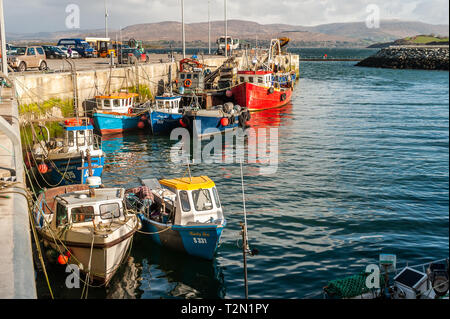 Bantry, West Cork, Ireland. 3rd Apr, 2019. The Bantry fishing fleet moored and ready for work. The day has started bright but with strong northerly winds. This afternoon will see prolonged showers with highs of 6 to 9°C. Credit: Andy Gibson/Alamy Live News. - Stock Image