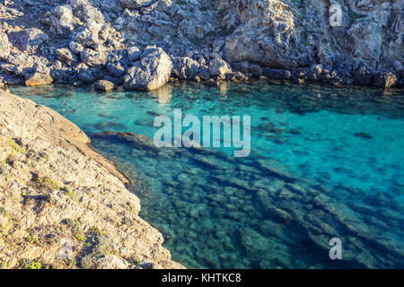swimming in rock lagoon - Stock Image