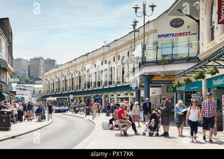 21 May 2018: Torquay, Devon, UK - Shopping in Fleet Street, with the Fleet Walk shopping mall, on a warm spring day. - Stock Image