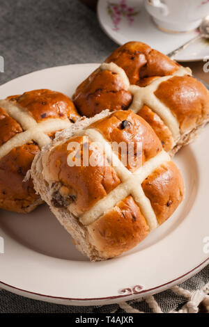 Hot Cross Buns a spiced sweet cake traditionally eaten on Good Friday - Stock Image