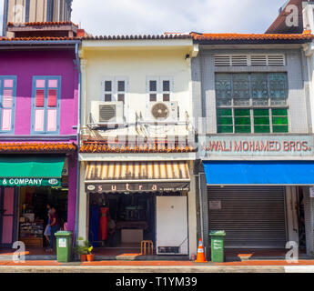 Arab Street traditional shophouses fabric shops Kampong Glam Singapore. - Stock Image