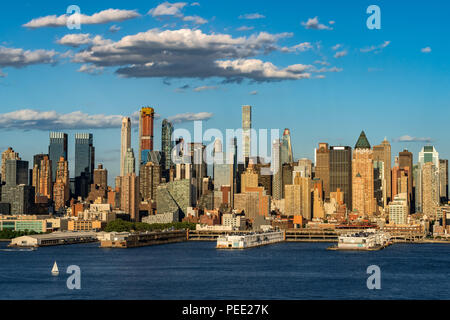 The skyscrapers of Manhattan Midtown West with the Hudson River in afternoon light. New York City - Stock Image