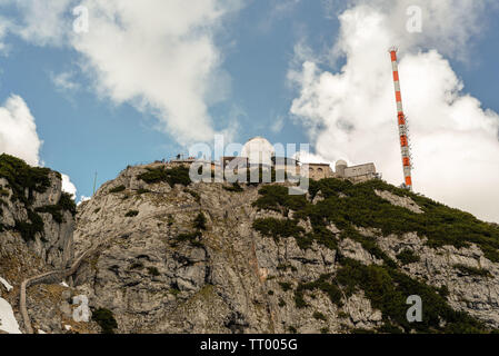 Bayrischzell, Bavaria, Germany - June 1, 2019. On top of Mount Wendelstein in Upper Bavari, a tourist attraction, there is a phone tower and views of - Stock Image