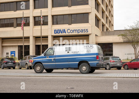 MACS armoured van or car stopped at a BBVA Compass bank in Montgomery Alabama, USA. - Stock Image
