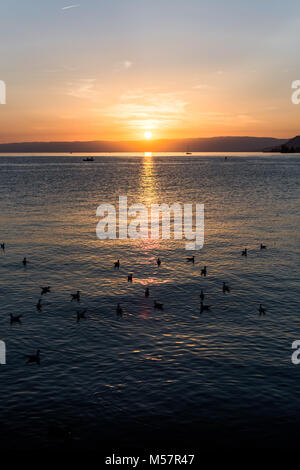 A beautiful sunset over the gorgeous lake in Switzerland - Stock Image