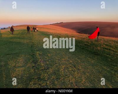 People walking and kiting on South Downs Way west of Ditchling Beacon, West Sussex, in glorious autumn afternoon sunshine. Credit: Johan Siebke/StockimoNews/Alamy Live News - Stock Image