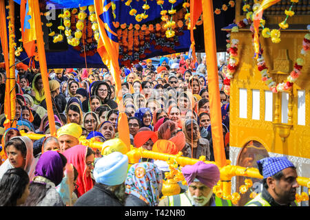 Gravesend, Kent, UK, 13th April 2019. Thousands of spectators and religious visitors line the streets of Gravesend in Kent to watch and participate in the annual Vaisakhi procession. Vaisakhi is celebrated by the Sikh community all over the world. - Stock Image