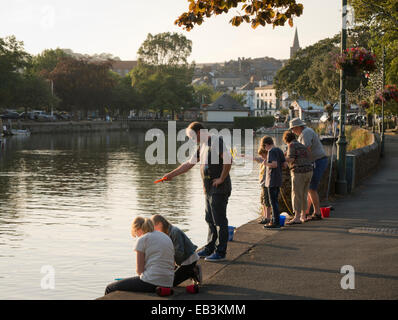 People crabbing on the Kingsbridge estuary in Kingsbridge South Devon - Stock Image