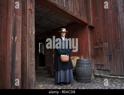Skansen open air museum, Djurgarden, Sweden. Re-enactors illustrate pre industrial life in early towns and villages. - Stock Image