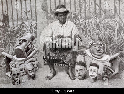 Bantu craftsman of Douala (Duala) making wooden carvings, Cameroon, Central West Africa (at the time a French colony). - Stock Image