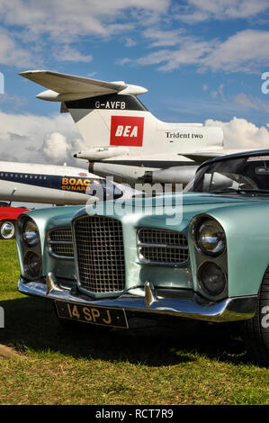 Vintage plane and car. Classic airliner BEA Hawker Siddeley Trident Two and BOAC Cunard Vickers VC10. Facel Vega HK500 classic French vehicle - Stock Image