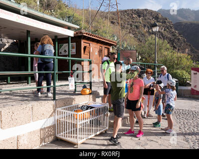 Family being fitted with safety helmets, about to enter the Barranco del Infierno, Adeje, Tenerife, Canary Islands - Stock Image