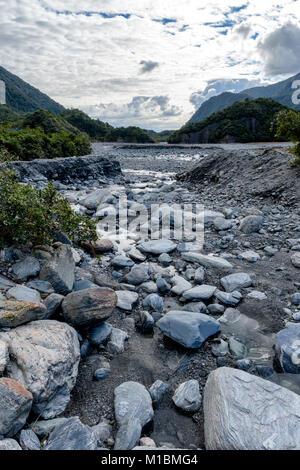 Franz Josef Glacier Walk – rock filled river - Stock Image