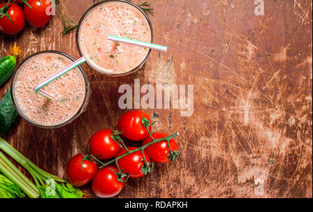 Vegetable smoothie. On rustic background - Stock Image