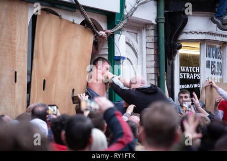 Struggles to retain the ball during the last moments of the Atherstone Ball game. A tradition dating back to the 12th century. - Stock Image