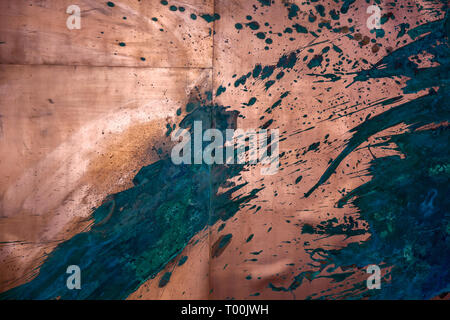 Abstract metal texture with paint splashes on the wall - Stock Image