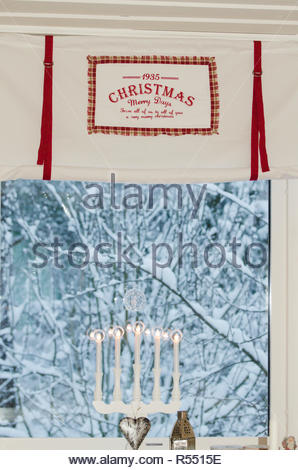 Romantic Christmas curtain with red ribbons and text - Stock Image