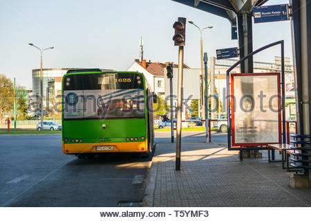 Poznan, Poland - April 18, 2019: Green public transport bus with number 165 waiting at a platform on the Rataje station. - Stock Image
