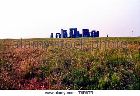 Salisbury, UK. Stonehenge, a Prehistoric Circle of Stones guarded by Authorities and Police to counter people gathering to celebrate the summer solsti. - Stock Image