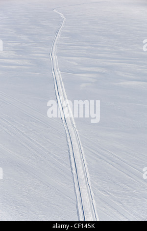 Snowmobile trail on snow and lake ice , Finland - Stock Image