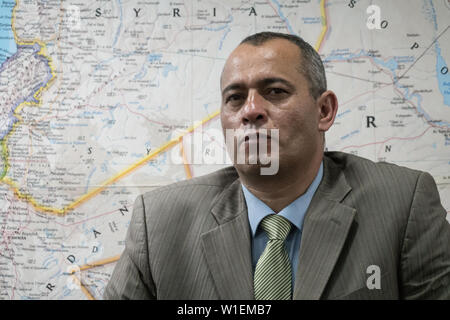 Jerusalem, Israel. 2nd July, 2019. Head of the Palestinian delegation of businessmen to the June 2019 US led economic workshop in Bahrain, ASHRAF AL JABARI, addresses the press in Jerusalem fearing Palestinian Authority vengance. The PA boycotted the 'Peace to Prosperity' workshop claiming it an attempt to buy off Palestinian political aspirations. Al Jabari, former member of PA security forces, stressed participation in the workshop had no political intentions.  Credit: Nir Alon/Alamy Live News. - Stock Image