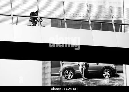 Cyclist on the footbridge over Via Melchiorre Gioia - Milan, Italy - Stock Image